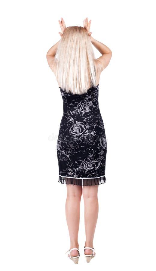 Achtermening van geschokte vrouw in kleding royalty-vrije stock afbeelding