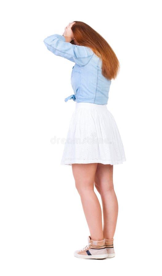 Achtermening van geschokte vrouw in kleding royalty-vrije stock afbeeldingen