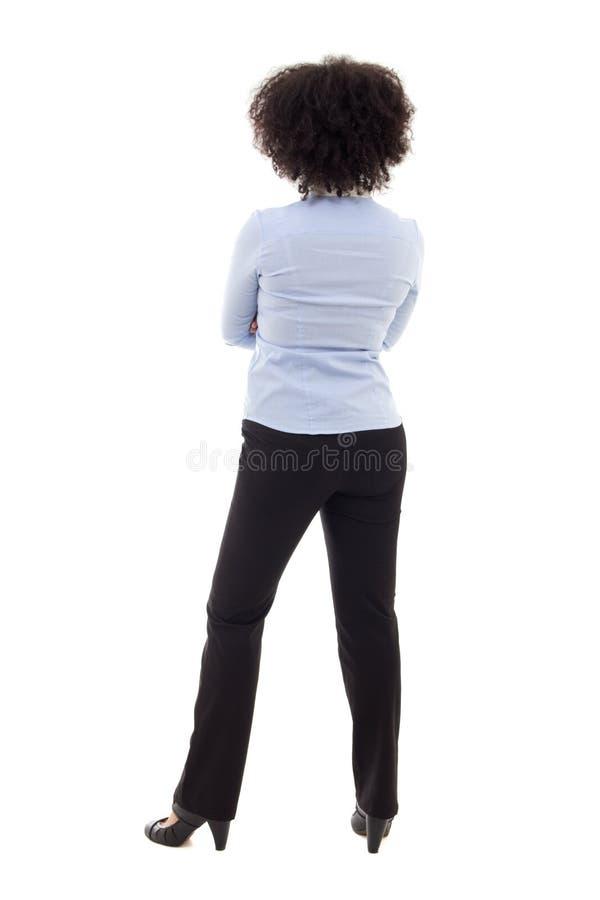 Achtermening van het jonge Afrikaanse Amerikaanse bedrijfsvrouw stellen isolat stock afbeelding