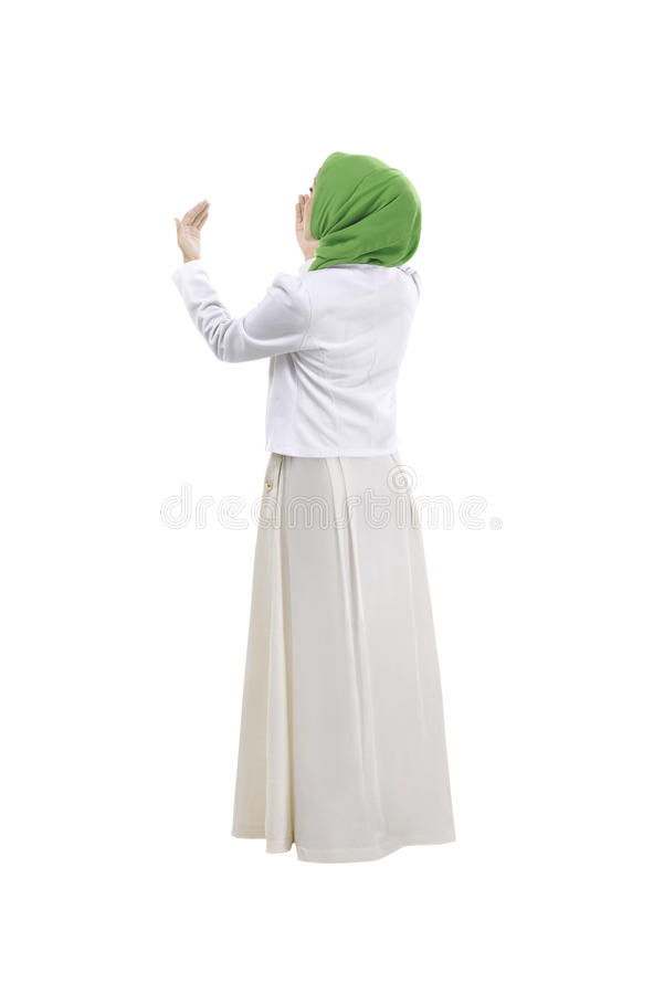 Achtermening van het moslimvrouw bidden royalty-vrije stock afbeelding