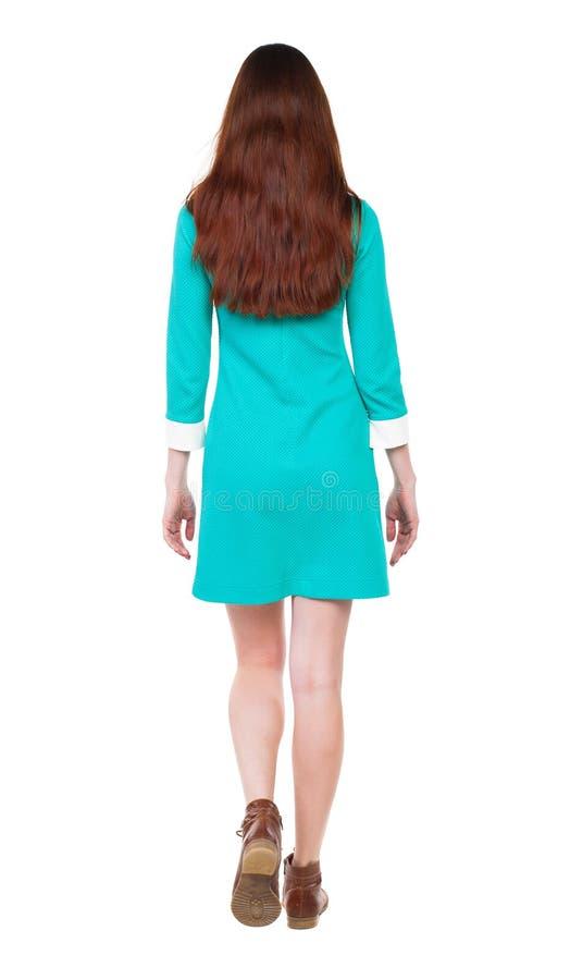 Achtermening van lopende vrouw stock foto