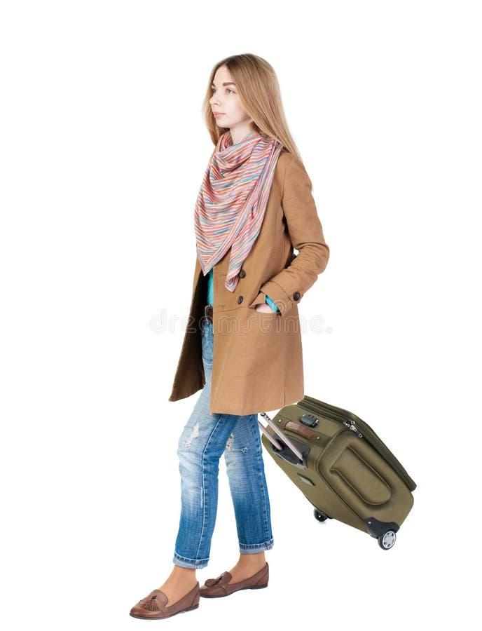 Achtermening van lopende vrouw met koffer mooi meisje in mo royalty-vrije stock fotografie