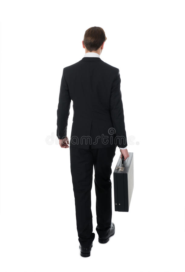 Achtermening van zakenman dragende aktentas royalty-vrije stock afbeeldingen