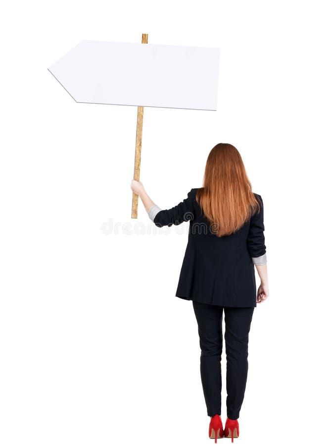 Achtermenings bedrijfsvrouw die tekenraad tonen stock afbeelding