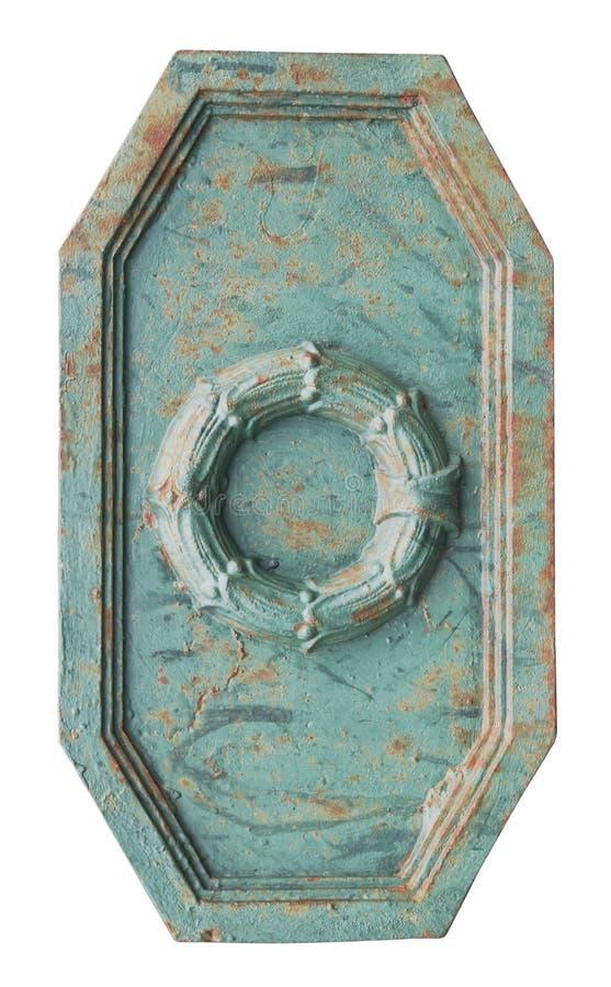 Achthoekige roestige groene metaaldecoratie in de vorm van een schild stock foto's