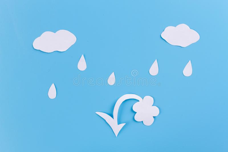 Acid rain concept. Paper cut of clouds and drops royalty free stock image