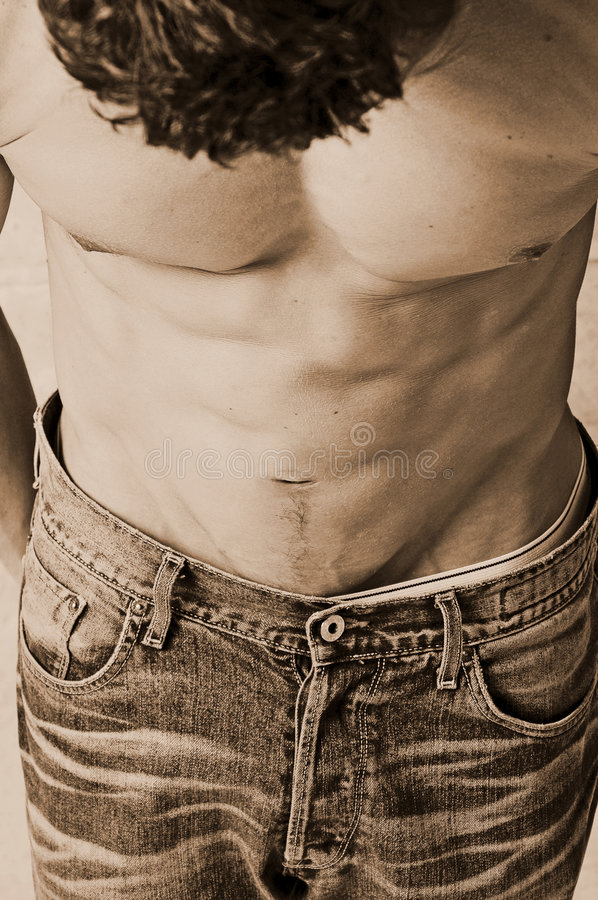 Acid washed jeans. Male from over head acid washed jeans torso sepia royalty free stock photography