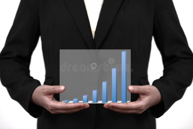 Acima do gráfico da venda do negócio da tendência na mão imagens de stock royalty free