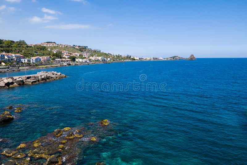 Acitrezza from Acicastello. Aci Castello Sicilian: Jaci Casteḍḍu is a comune in the Province of Catania in Sicily, Italy. The city is located 9 stock images