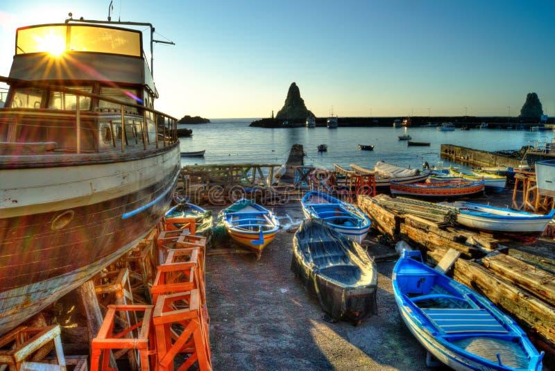 Acitrezza harbor with old boat royalty free stock photo