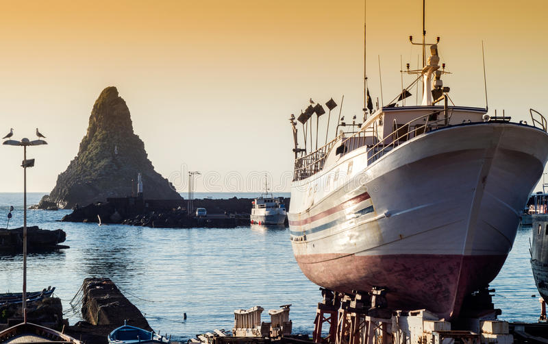 Acitrezza harbor with old boat royalty free stock image