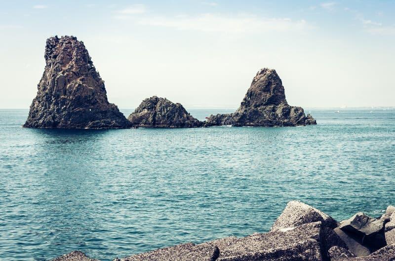 Acitrezza rocks of the Cyclops, sea stacks in Catania, Sicily, Italy.  royalty free stock photo