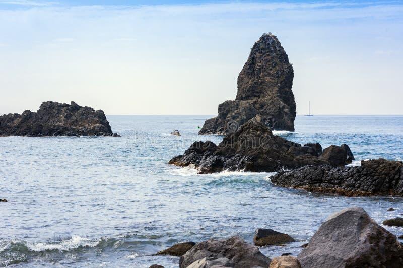 Acitrezza rocks of the Cyclops, sea stacks in Catania, Sicily, Italy.  stock photo