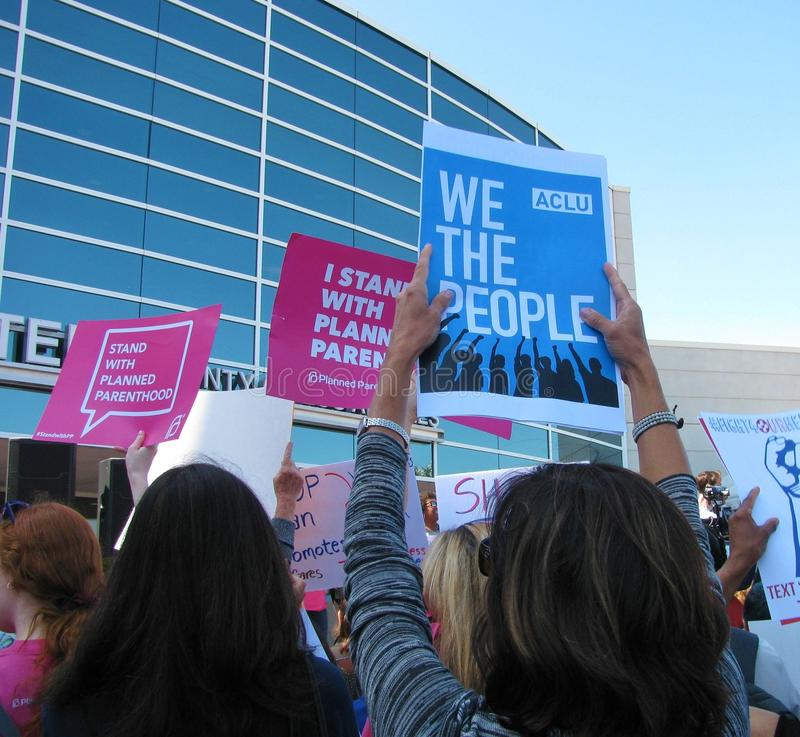 ACLU and Planned Parenthood signs at Los Angeles area healthcare rally. TORRANCE, CALIFORNIA - JULY 3, 2017: Demonstrators hold signs at a rally to stop stock photo