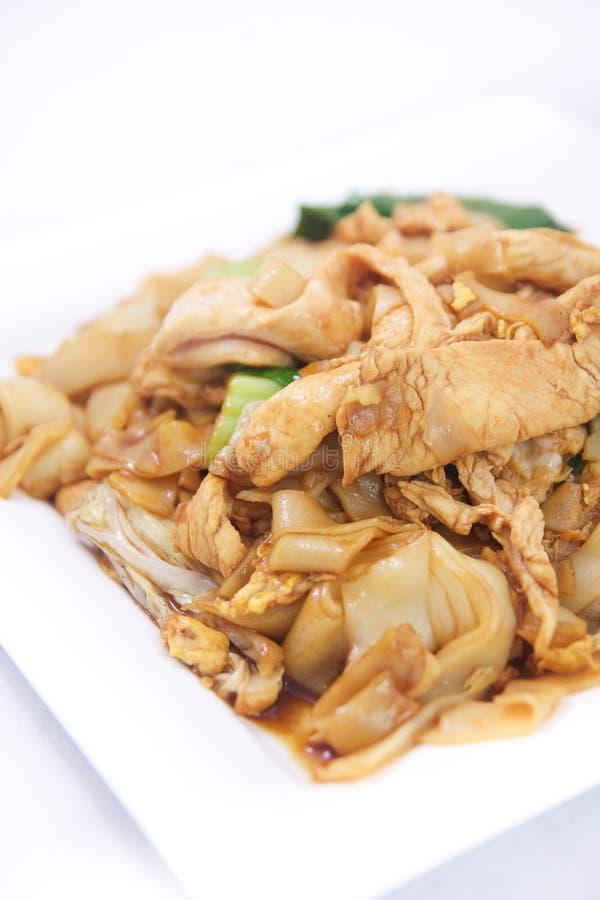 Acolchoe SE ew, macarronetes de arroz lisos fritados agitação com molho da ostra. foto de stock royalty free