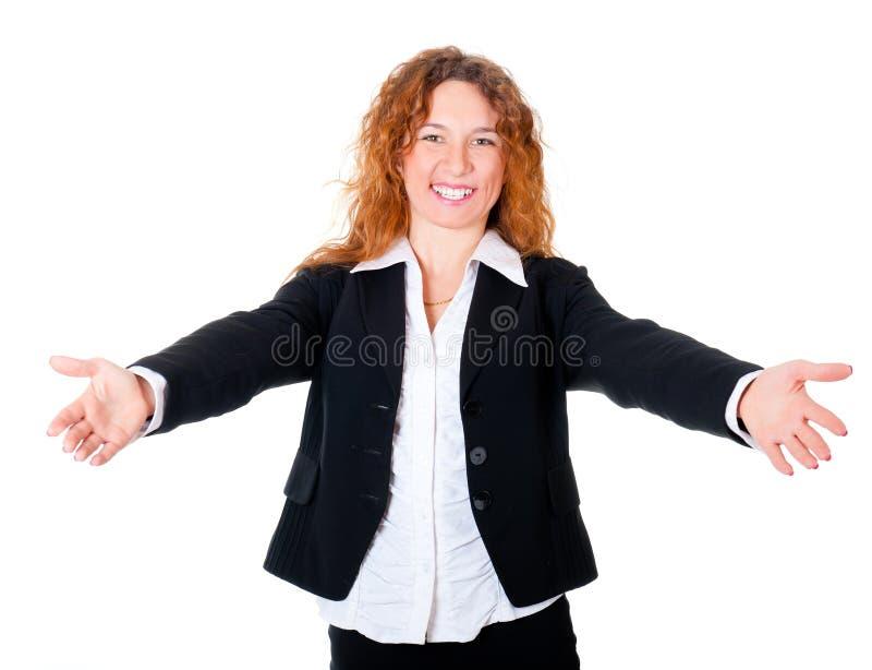 Acolhimento de sorriso amigável da mulher de negócio imagem de stock royalty free