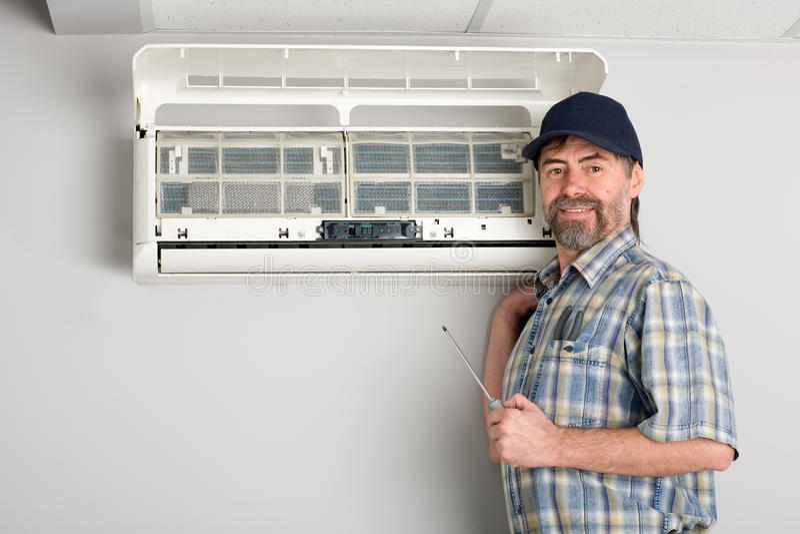 Acondicionador de aire del reparador foto de archivo libre de regalías