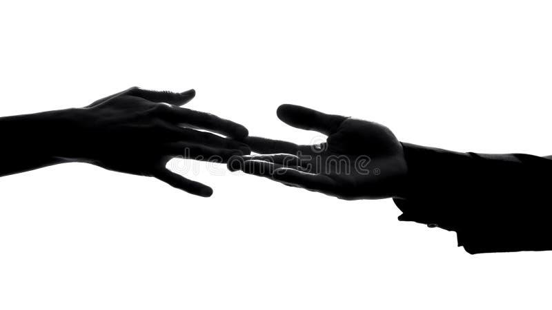 Acople as mãos que separam, relações opõem, perdendo o sócio do amor, símbolo da dissolução fotografia de stock royalty free