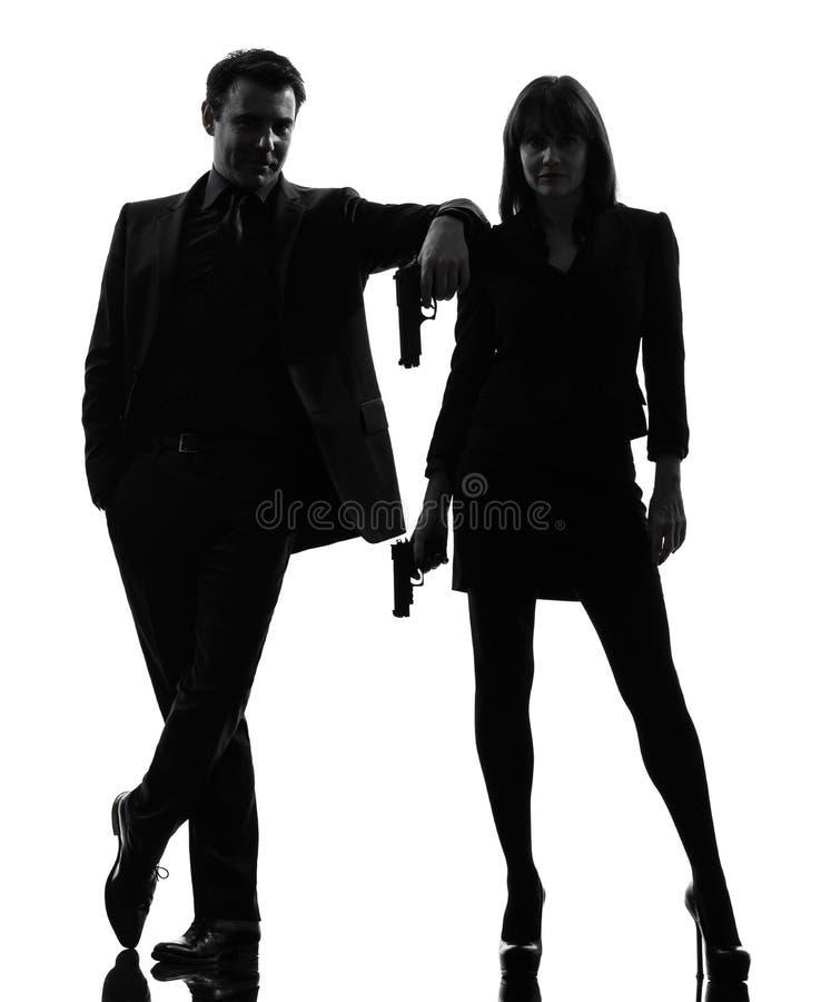 Acople a silhueta do criminoso do agente secreto do detetive do homem da mulher fotos de stock royalty free