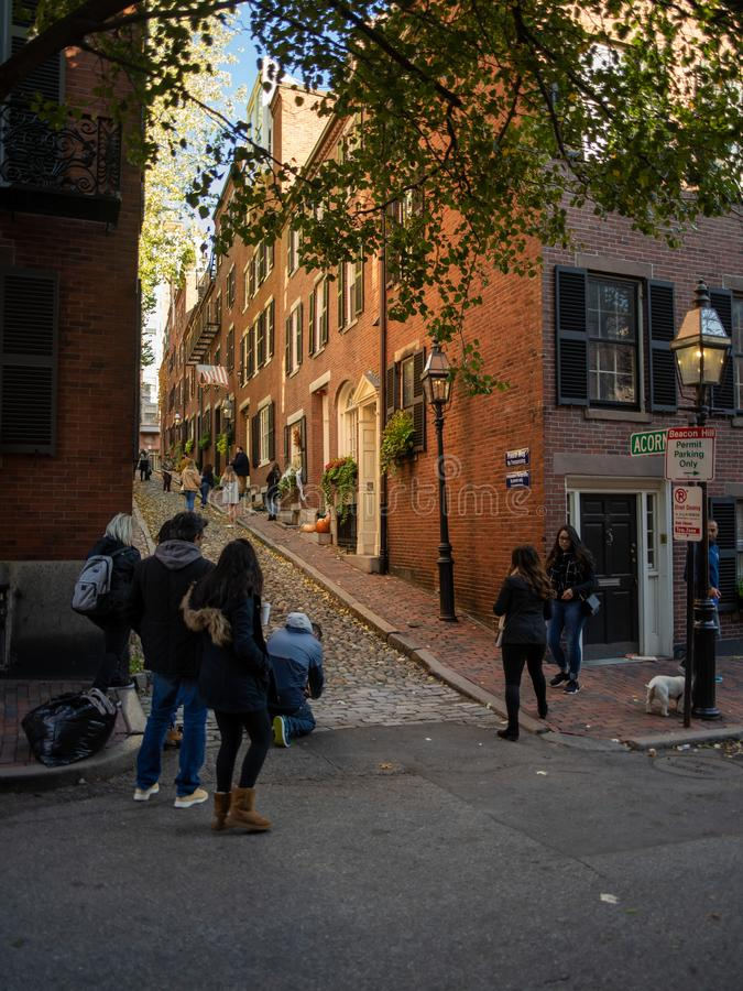 Acorn St. Boston Massachusetts with People Taking Pictures. A favorite street in Boston for people to take pictures and selfies with cobblestones and brick walls royalty free stock photo