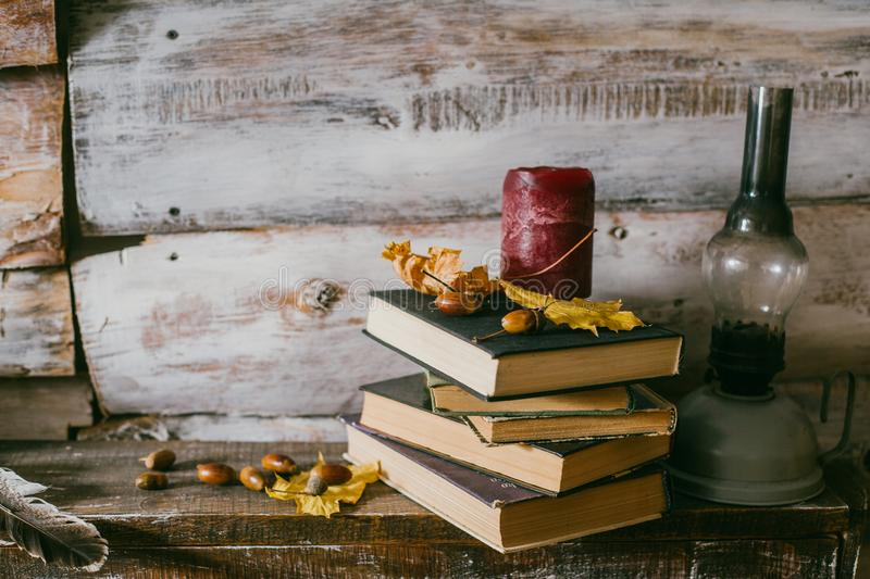 Time to read books. books, candle and oli lamp on the table. woo royalty free stock photos