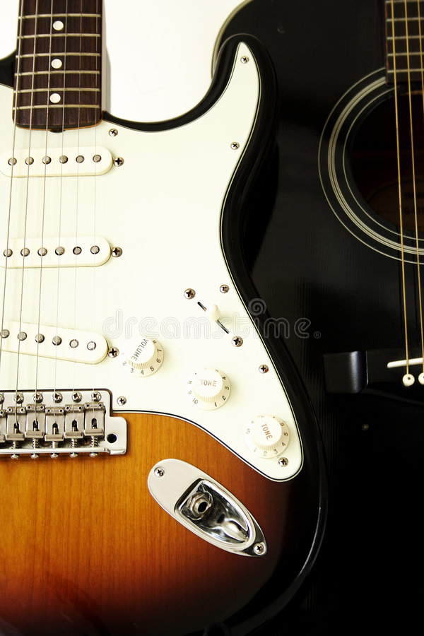 Free Acoustic And Electric Guitars Royalty Free Stock Photos - 9106388