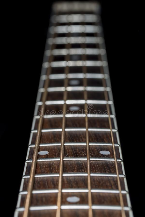 Download Acoustic Bass Guitar Fretboard Close Up Stock Photo