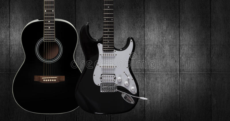 Acoustic and electric guitar. Acoustic and electric guitar on dark black wooden background stock image