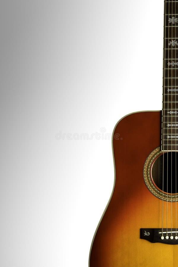 Acoustic Guitar. Reddish/Orange acoustic guitar on a white background stock image