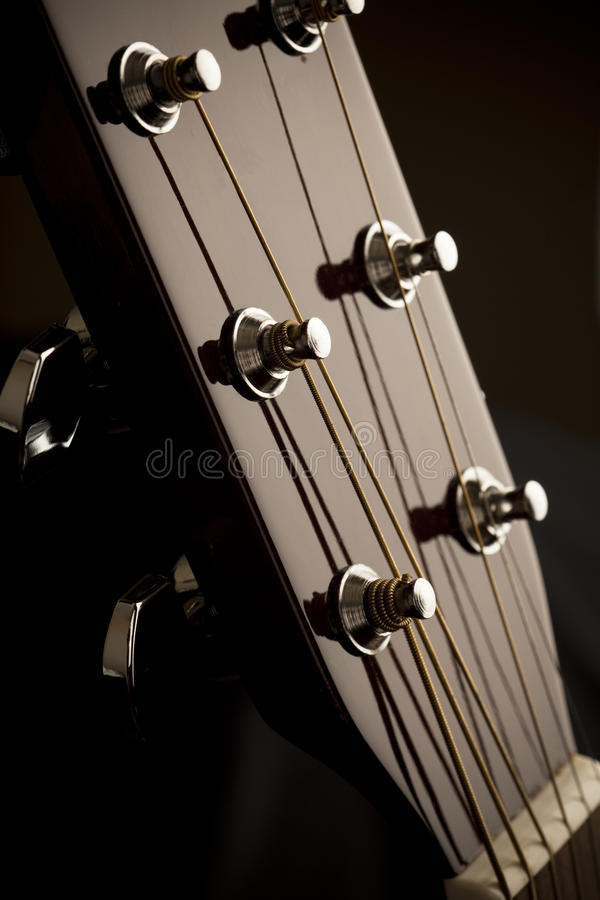 Acoustic Guitar. Head with tuning pegs stock photo