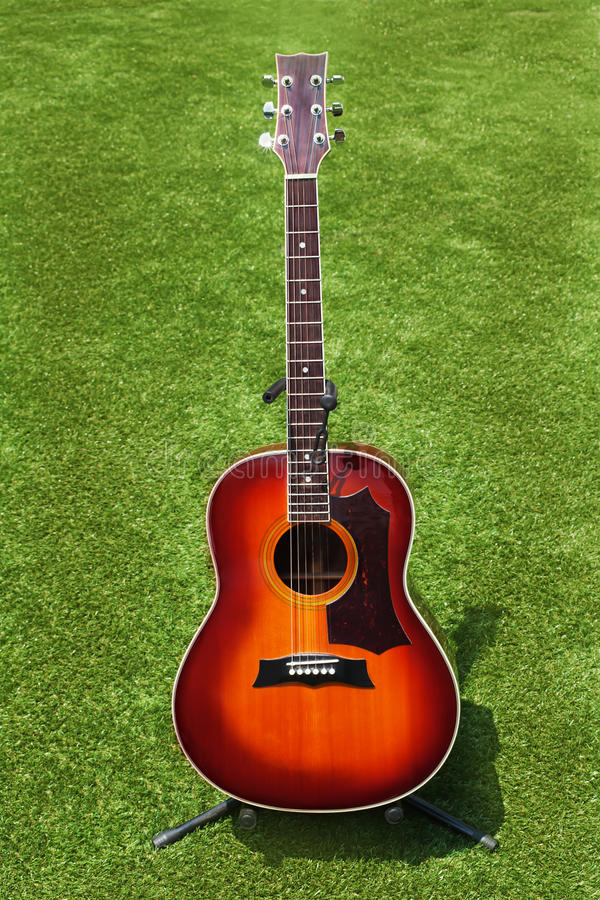 Download Acoustic Guitar On Background Of Green Grass. Stock Image - Image: 29257653