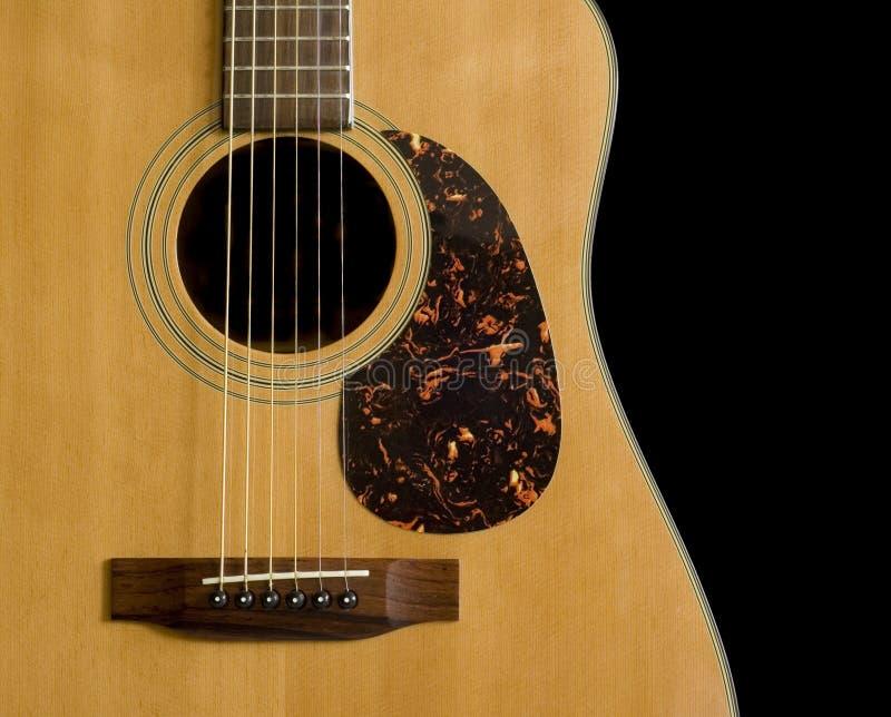 Acoustic Guitar on Black Background. Acoustic Guitar Close-up on Black Background stock photo