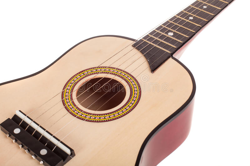 Acoustic guitar bridge and strings close up, isolated royalty free stock photography