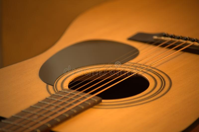 Acoustic guitar photo in cozy, warm tones royalty free stock photography