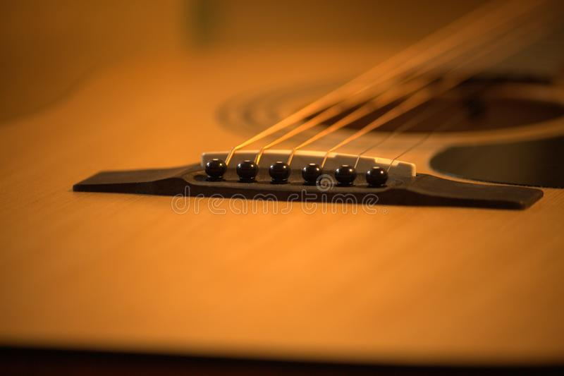 Acoustic guitar photo in cozy, warm tones royalty free stock images