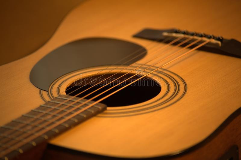 Acoustic guitar photo in cozy, warm tones stock image