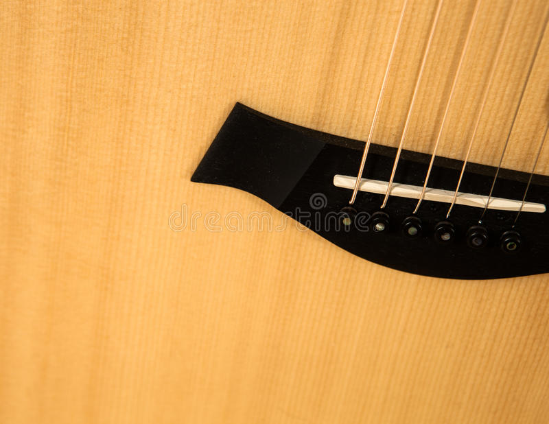 Acoustic guitar close-up. Detailed image of the guitar bridge. royalty free stock photos