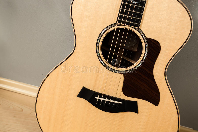 Acoustic guitar close-up. Detailed image of the guitar stock photos
