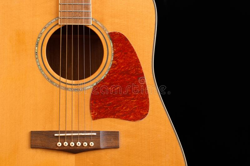 Acoustic Guitar Detail. Isolated on black royalty free stock image