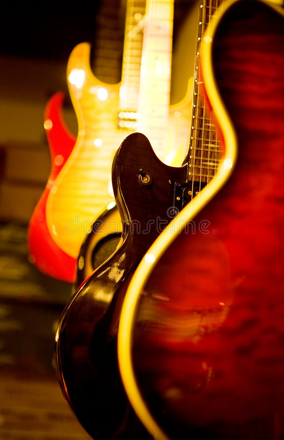 Acoustic guitar and electric guitars stock images