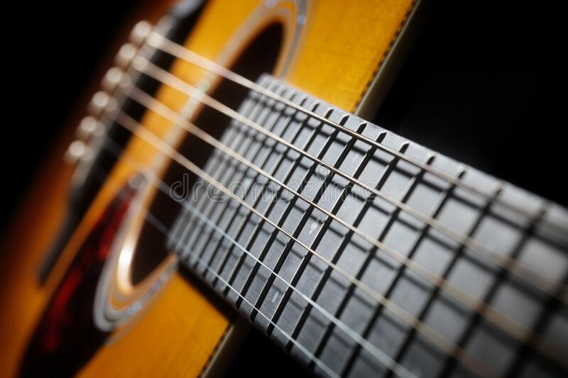 Acoustic guitar fret board. Frets strings and sound hole stock photography