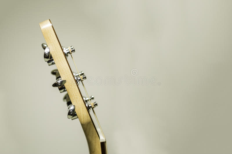 Acoustic Guitar Head and Tuning Pegs. A look at the head of an acoustic guitar stock photography