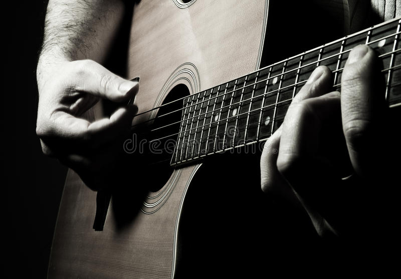 Acoustic guitar. Image is posed on dark background royalty free stock photos