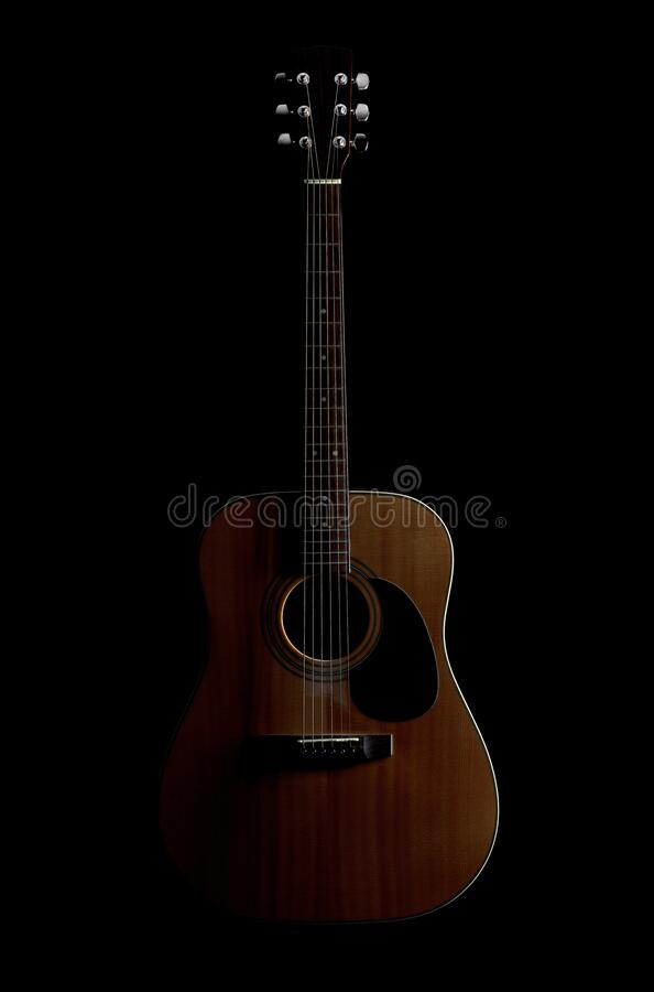Acoustic Guitar. An acoustic guitar, isolated on black royalty free stock photo