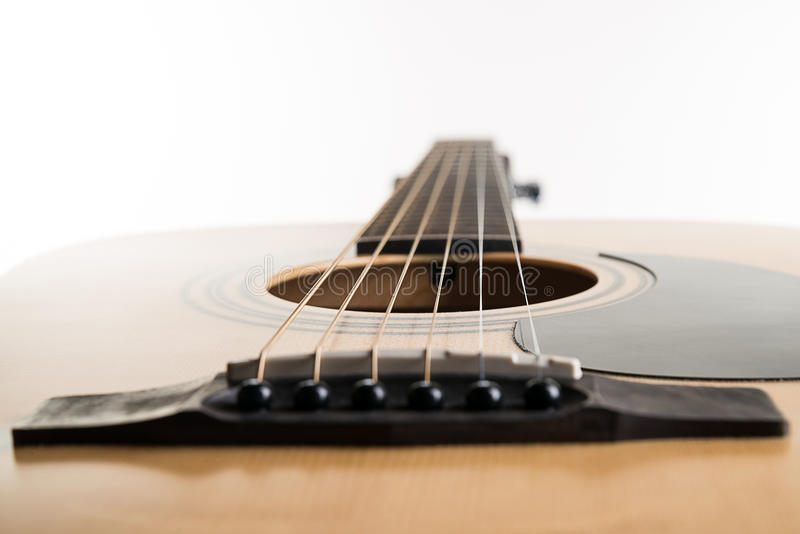Acoustic guitar lies in a frame on a white isolated background. Horizontal frame stock image