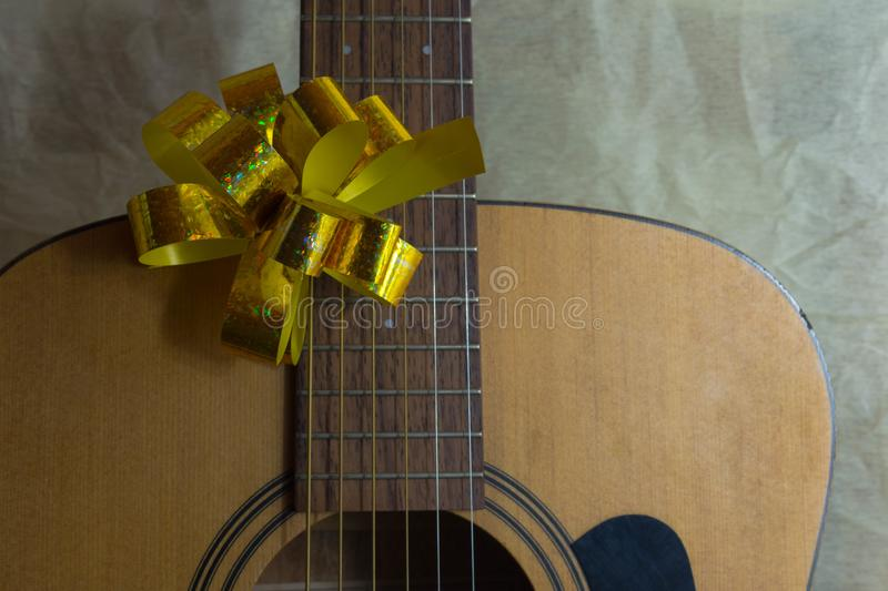 Acoustic guitar with lighted garland stock photo