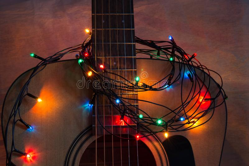 Acoustic guitar with lighted garland royalty free stock images