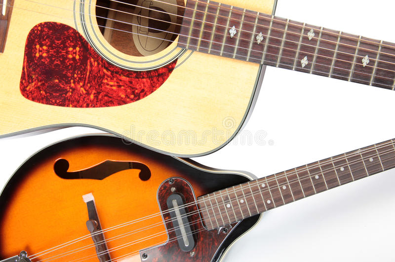 Acoustic guitar and mandolin. Color photo of a mandolin and guitar in country style stock photography