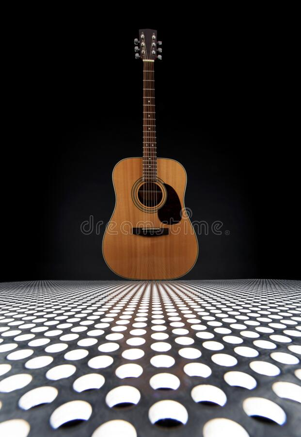 Acoustic Guitar On Metal Plate With Holes  royalty free stock image