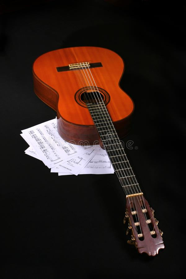 Acoustic guitar with music sheets royalty free stock photos